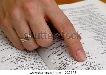 Hand on a bible - stock photo