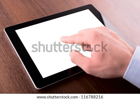 hand on a touch screen of tablet computer, with clipping path