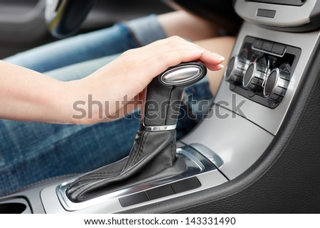 hand on automatic gear shift, woman in luxury car #143331490