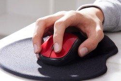 hand on computer mouse in close-up