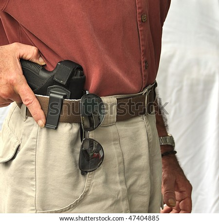 Hand On Concealed Weapon