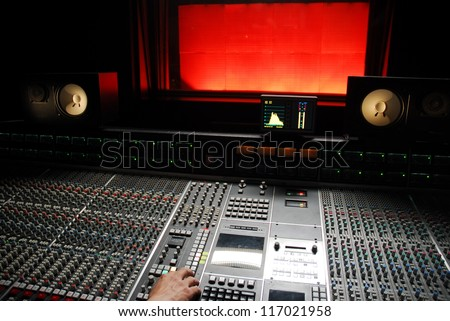 hand on mixer in the recording studio