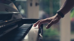 Hand On Piano Key