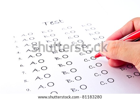 Hand on red pen choosing the test list on the examination