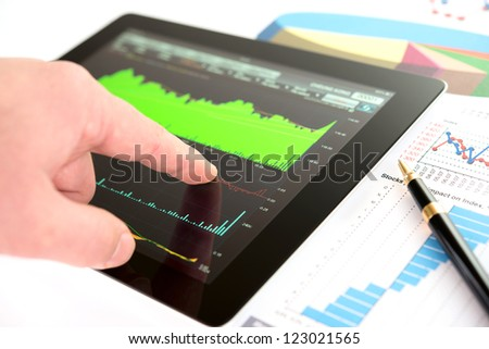 Hand on screen tablet pc with business information
