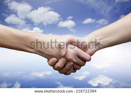 hand on sky background.The partnership concept.