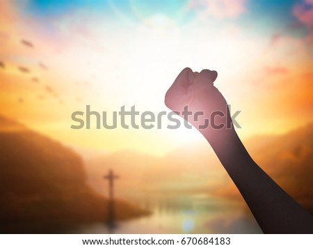 Hand on sunset background success, peace, freedom business concept - Shutterstock ID 670684183
