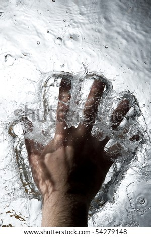 Hand on the Black water . Creative splashing dark water