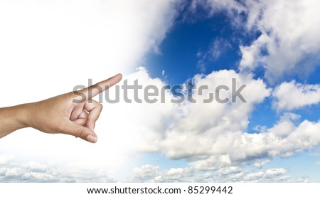hand on the blue clear sky. Woman's hand with index finger.