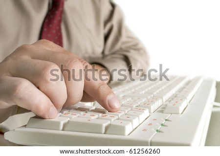 hand on the computer keyboard