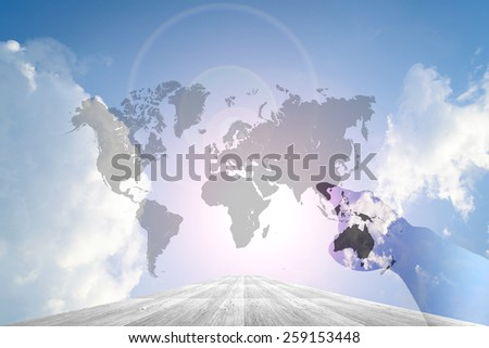 Hand on Wood way and Blue sky background with world map