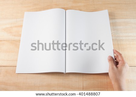 hand open blank\ book or magazines, \book mock up on wood background