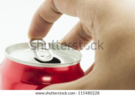 hand opening red aluminum can, isolated on white background