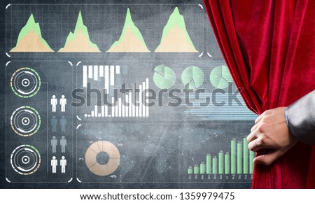 Hand opening red curtain and drawing business graphs and diagrams behind it #1359979475