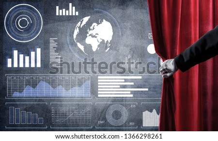 Hand opening red curtain and drawing business graphs and diagrams behind it #1366298261