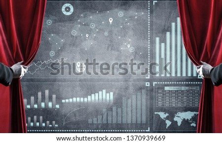Hand opening red curtain and drawing business graphs and diagrams behind it #1370939669