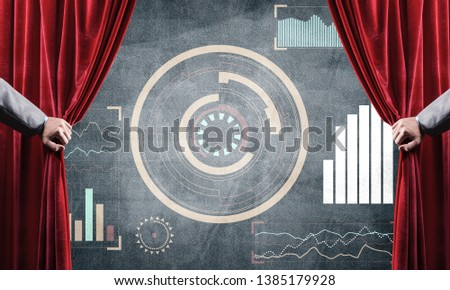 Hand opening red curtain and drawing business graphs and diagrams behind it #1385179928