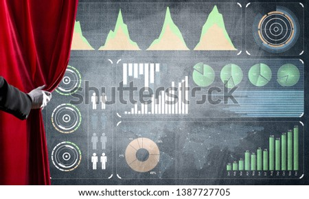 Hand opening red curtain and drawing business graphs and diagrams behind it #1387727705