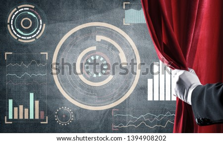 Hand opening red curtain and drawing business graphs and diagrams behind it #1394908202