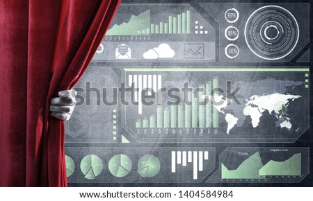 Hand opening red curtain and drawing business graphs and diagrams behind it #1404584984