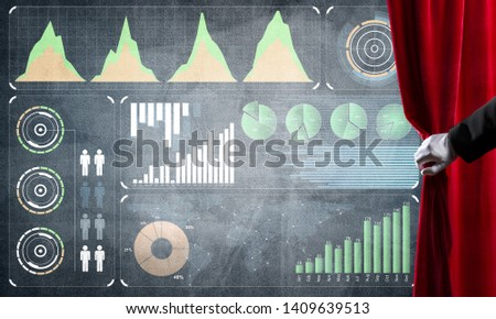 Hand opening red curtain and drawing business graphs and diagrams behind it #1409639513