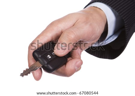 Hand opening the car door with a remote control