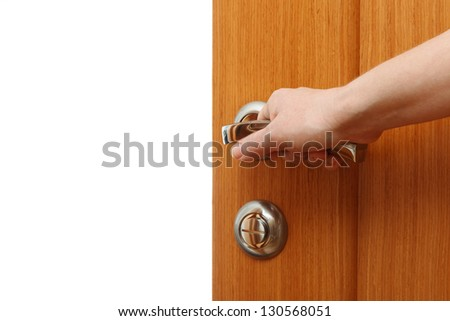 Hand opening the door. Horizontal format over a white background with copy space