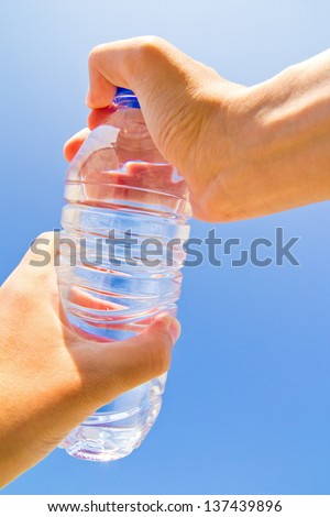 lid of the bottle isolated on a blue background of sky - stock photo
