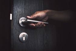 hand opening unlock the door at night