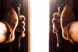 hand opens empty room door