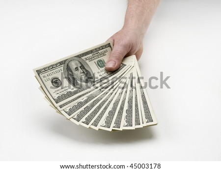 hand or hands holding many 100 dollar bills on white background
