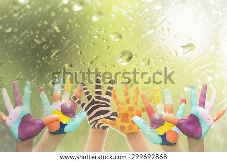 Hand Painted Child. Isolated on white background.animal hand paint concept.giraffe and zebra hand paint on window with water drop background.
