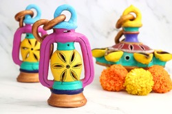 Hand-painted Decorative clay lamps for the festival of lights Diwali. Indian Traditional clay hanging lamps. Happy Diwali banner. Copy space.