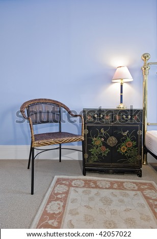 hand painted designer bedside table with reading lamp and chair