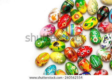 Hand painted Easter eggs isolated on white. Floral, colorful spring patterns and designs. Traditional, artistic and unique. #260562554