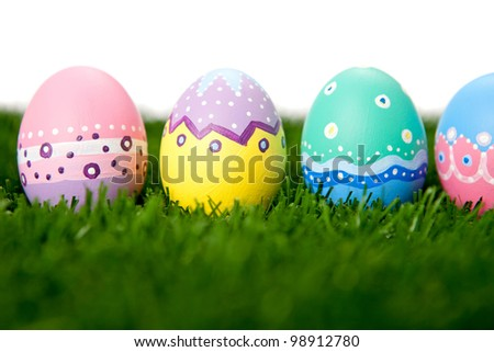 Hand painted Easter eggs lying on grass