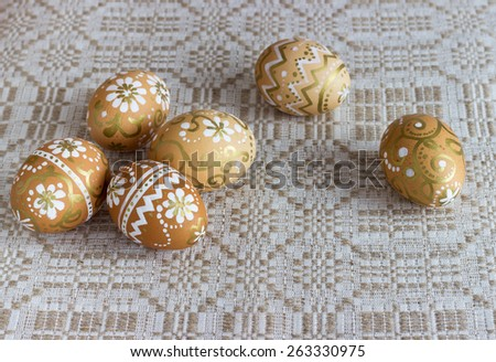 hand-painted Easter eggs on a cloth background #263330975