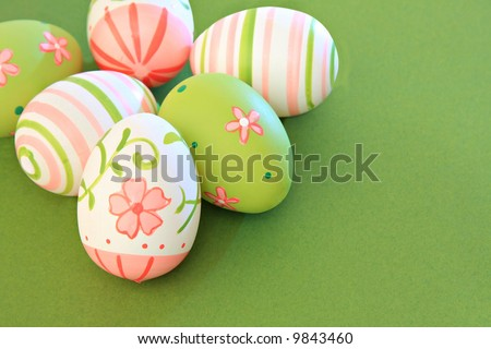 Hand painted easter eggs on green.