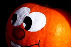 Hand painted pumpkin with grinning face - close up