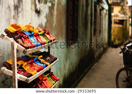 Hand painted women's shoes for sale in a Vietnamese street market