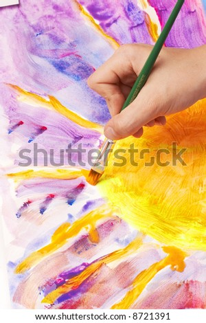 hand painting a sun, fluorescent colors