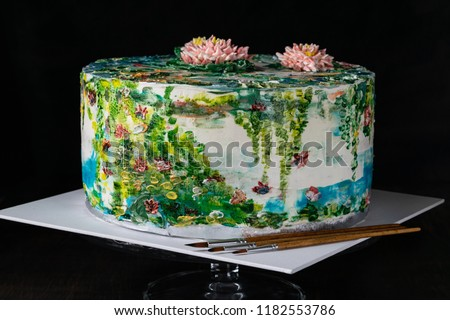 Hand painting buttercream water lilies cake. Homemade baking. Decorating cream cake with food coloring. Designer Cake. Selective focus. Horizontal.