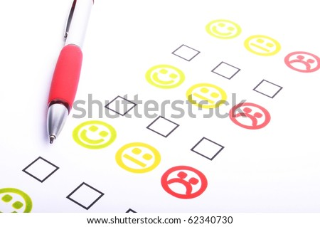 hand pen and check box or tick box with smilie