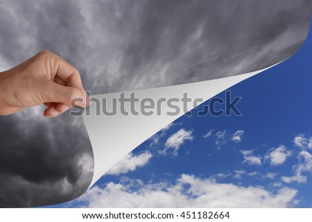 Hand pick and pull paper or curtain from bad cloudy sky to be clear bright blue sky and white cloud. Conceptual illustration of optimistic idea, change, opportunity, or better step.