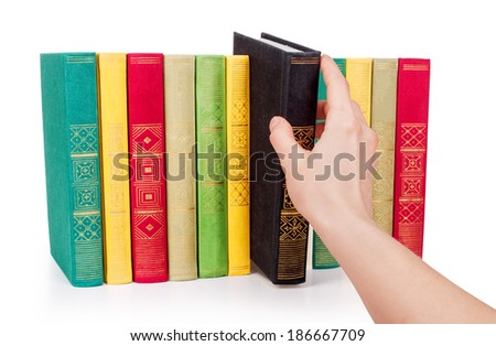Hand picking book in library