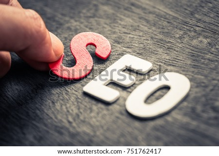 Hand place wood letters for SEO word