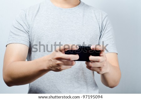 Hand play game on mobile phone
