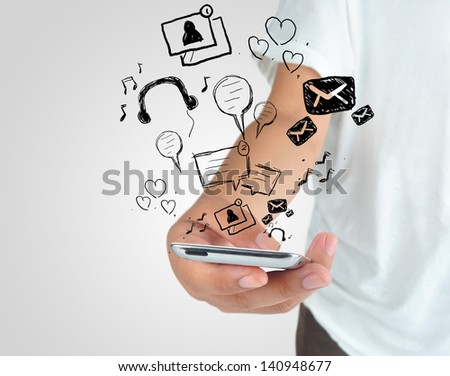 Hand playing modern mobile phone application