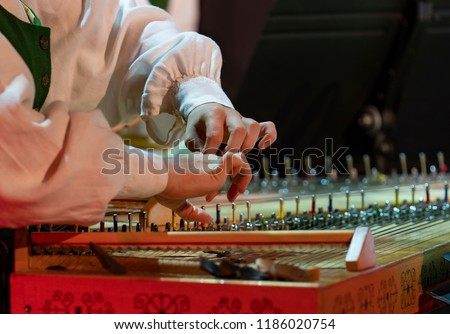 Hand playing on kokle a Latvian plucked string instrument belonging to the Baltic box zither family. #1186020754