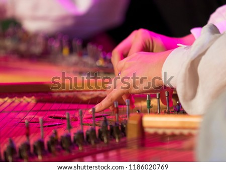 Hand playing on kokle a Latvian plucked string instrument belonging to the Baltic box zither family. #1186020769
